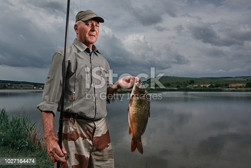 lifestyle shot of senior man at retirement enjoying fishing.