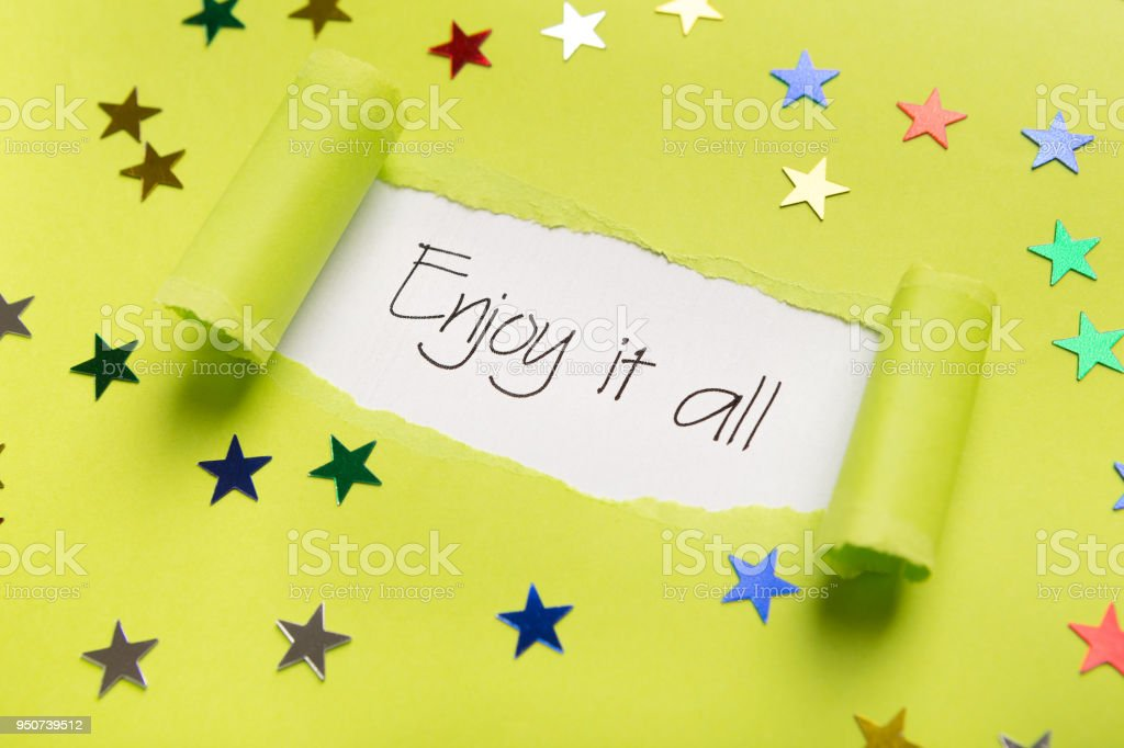 Enjoy it all phrase showing up under torn yellow paper