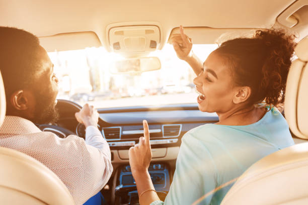 Enjoy Journey. Couple Listening Music In Car Enjoy Journey. Afro Couple Listening Music, Driving Car singing stock pictures, royalty-free photos & images