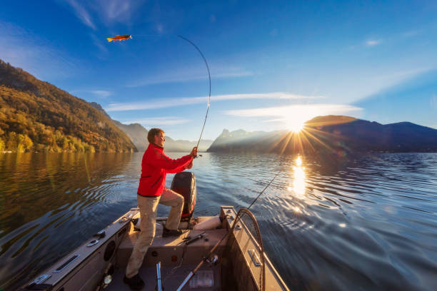 Enjoy my leisure time - fishing at alpin lake Fishing, Autumn, Dawn, Freshwater Fishing, Spin fishing freshwater fishing stock pictures, royalty-free photos & images