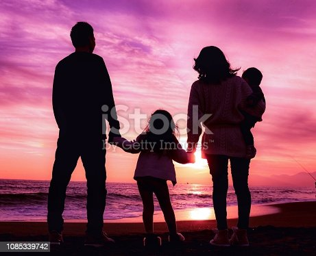 A family enjoy weekend at the beach.