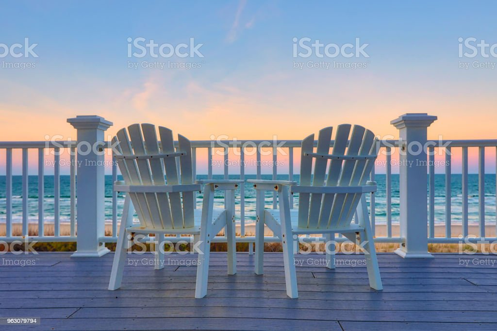 Enjoy the view of the ocean from a chair while on vacation stock photo