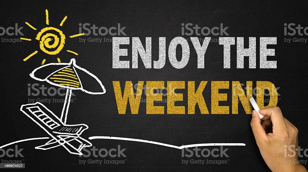 enjoy the weekend concept on blackboard stock photo