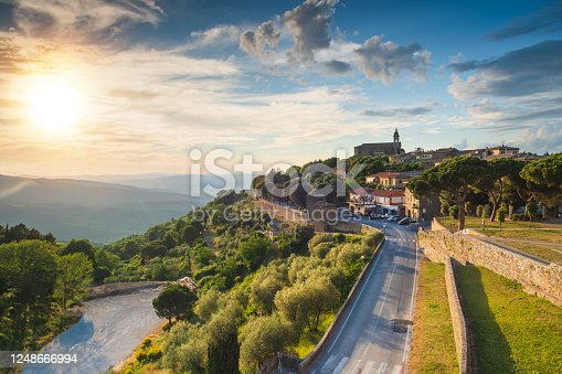 enjoy travel italy street in small historic medieval town village in Tuscany during sunny summer and orange yellow multicolored vibrant colorful walls