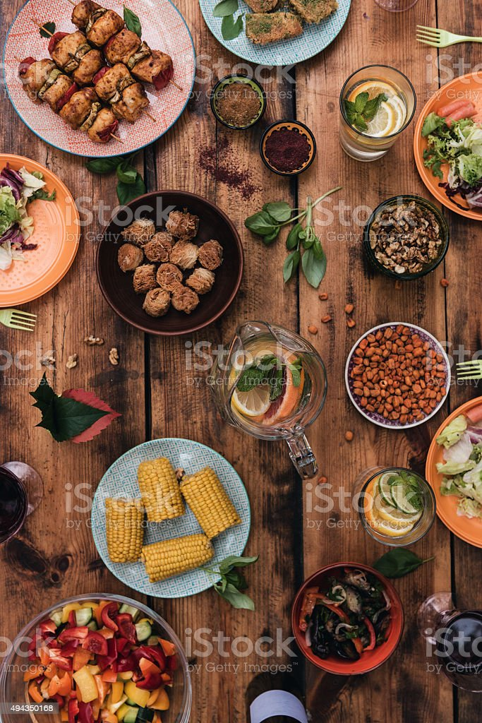 Enjoy your dinner! Top view of food and drinks on the rustic wooden table 2015 Stock Photo
