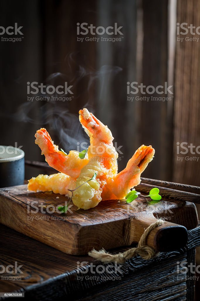 Enjoy your shrimp in tempura with red sauce stock photo