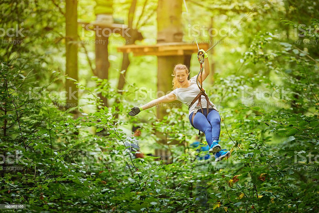 enjoy zipping in forest stock photo