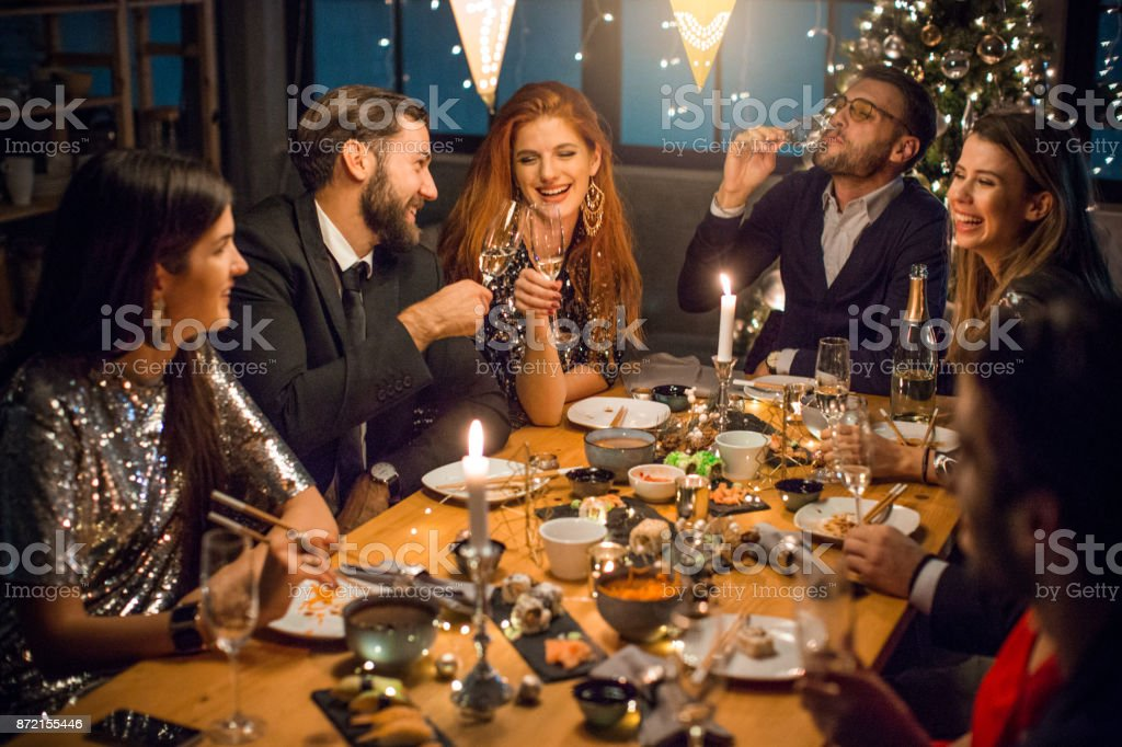 enjoying a christmas dinner party with friends royalty free stock photo - Christmas Dinner Party
