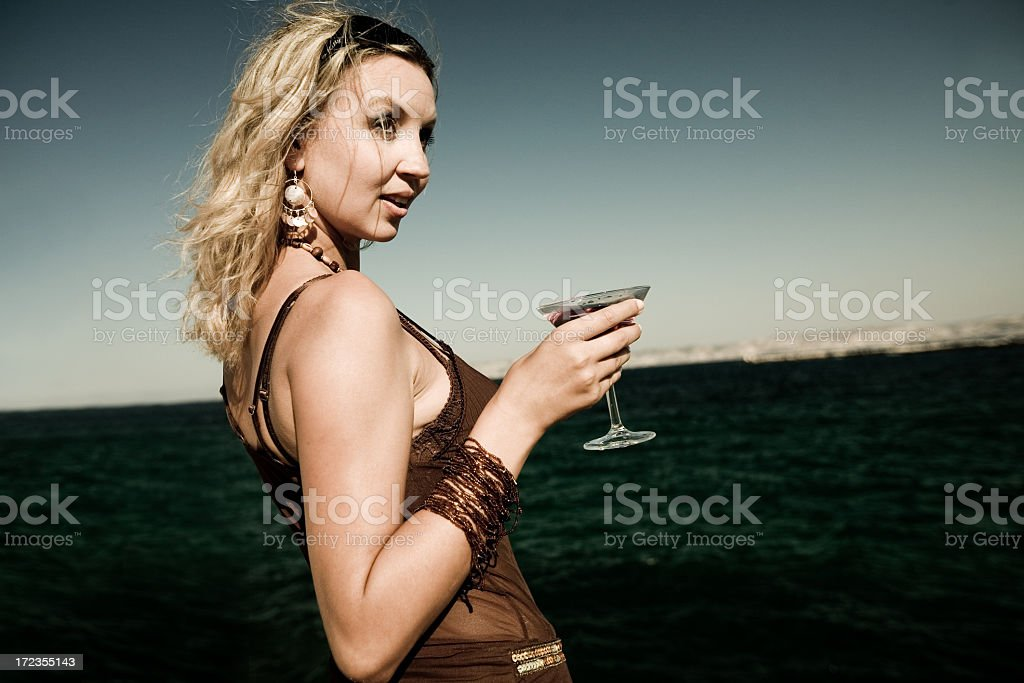 enjoying a cocktail royalty-free stock photo