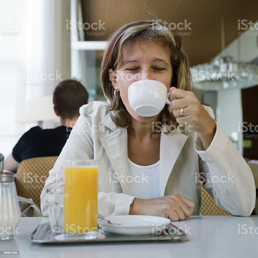 enjoying a cup of coffee royalty-free stock photo