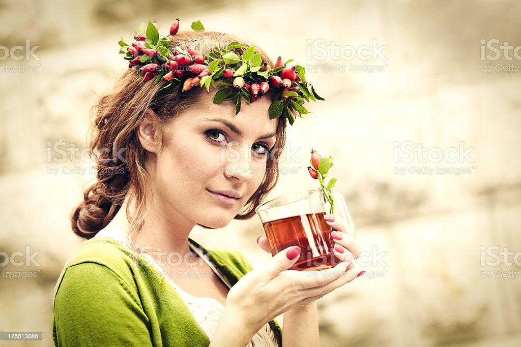 Enjoying a cup of rosehip tea stock photo