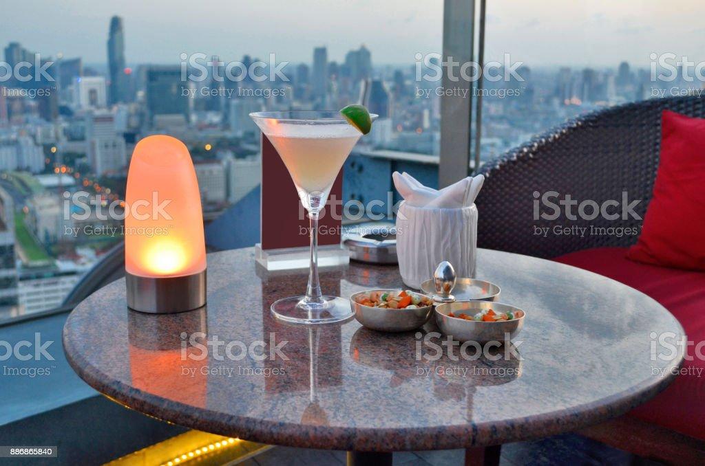 Enjoying a daiquiri at a rooftop bar of Bangkok stock photo