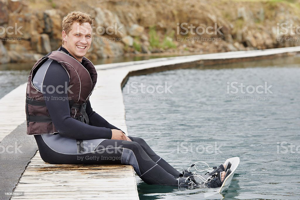 Enjoying a day of wakeboarding at the dam royalty-free stock photo