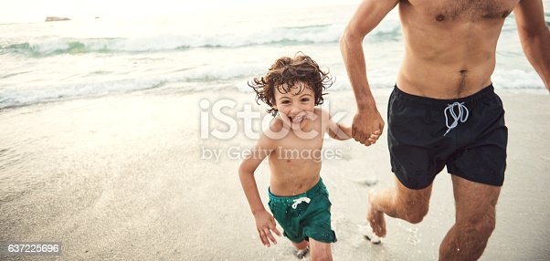istock Enjoying a day with dad at the beach 637225696