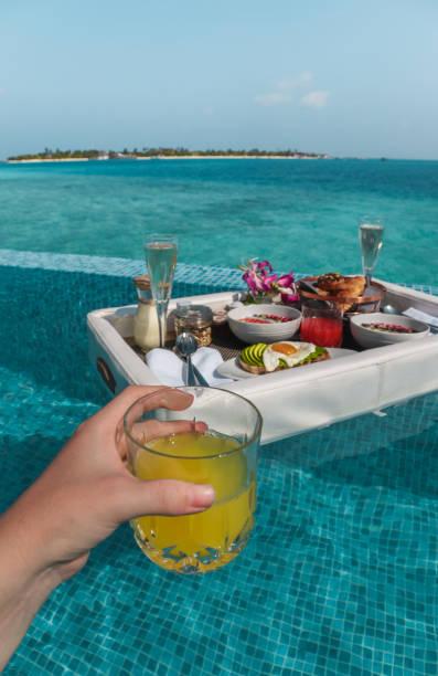 Enjoying a floating breakfast in Maldives stock photo