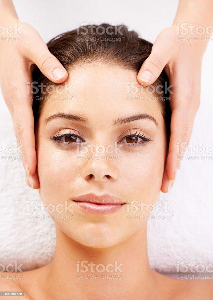 Enjoying a head massage royalty-free stock photo