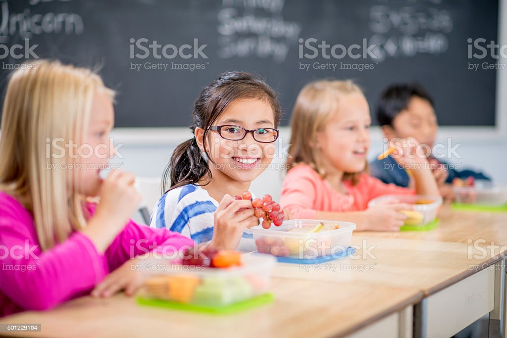 Enjoying a Healthy Snack at School stock photo