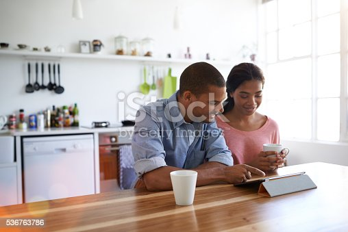 istock Enjoying a morning internet catch up together 536763786