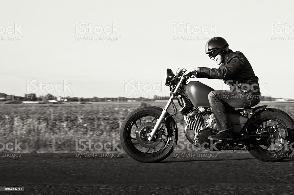 Enjoying a motorcycle ride in the sunset stock photo