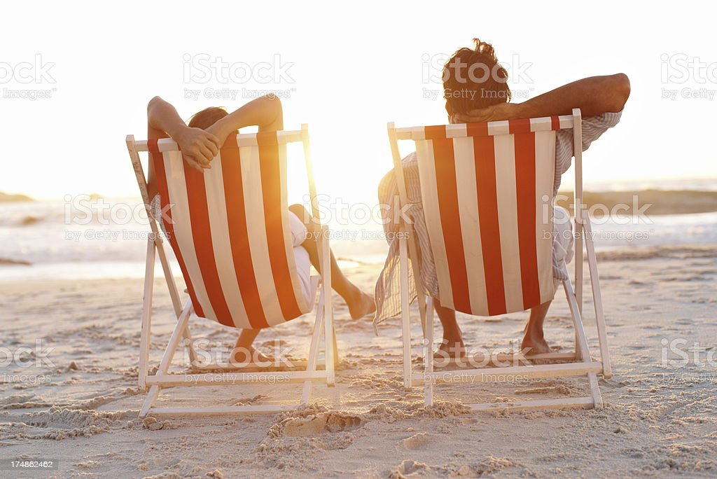 Enjoying a peaceful sunset together royalty-free stock photo