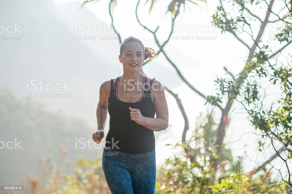 Enjoying a Run in the Hawaiian Mountains stock photo