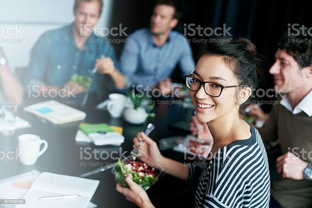 Enjoying a team lunch! stock photo