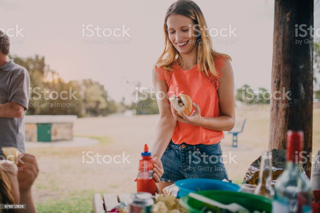 Enjoying a Veggie Burger at a BBQ stock photo