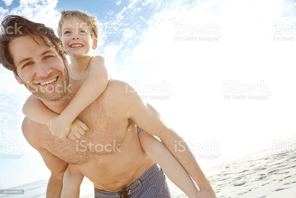 Enjoying a warm beach day with his son stock photo