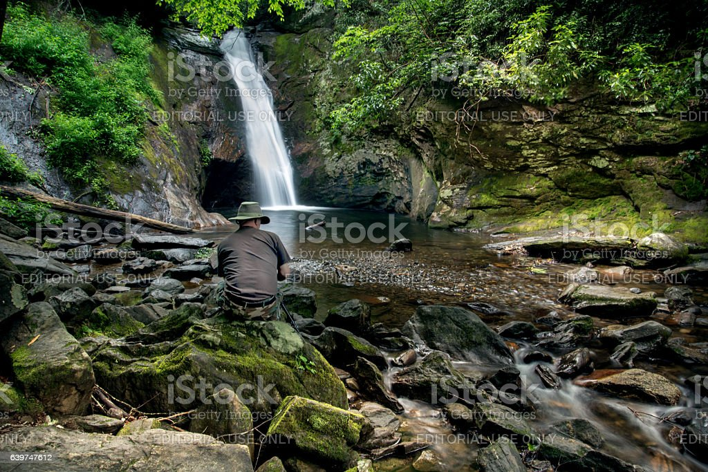 Enjoying a waterfall stock photo
