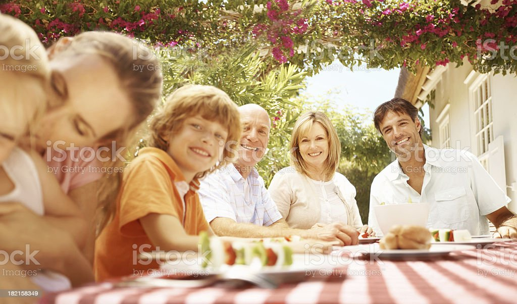 Enjoying a wholesome family mealtime stock photo