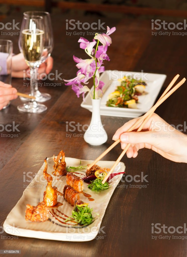 Enjoying an Asian Style Meal royalty-free stock photo