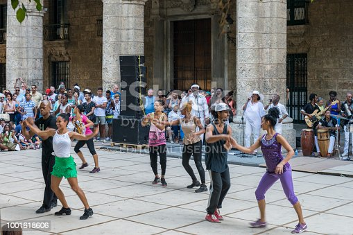 A group of cuban young people are enjoying and dancing