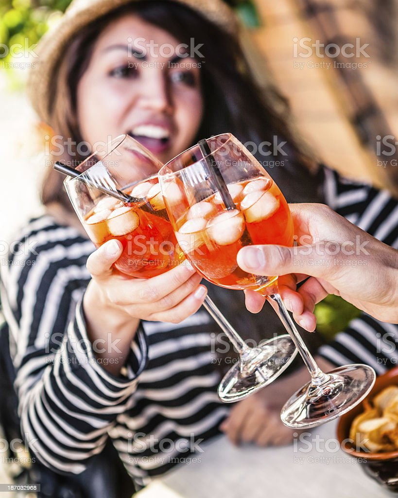 Enjoying Aperitif with Alcoholic Drink, Italian Spritz royalty-free stock photo