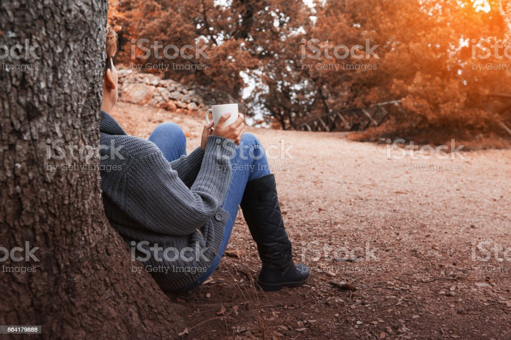 Enjoying autumn forest with a cup royalty-free stock photo