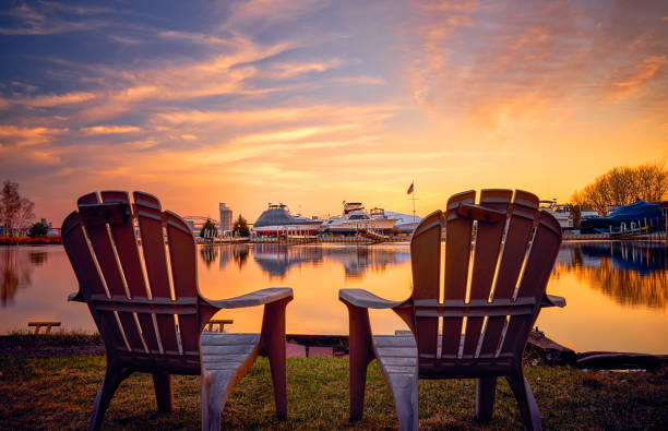 Enjoying Beautiful Sunset at Park Point, Duluth, MN Relaxing feel with two chairs on the bay side of the Park Point, Duluth, MN minnesota stock pictures, royalty-free photos & images