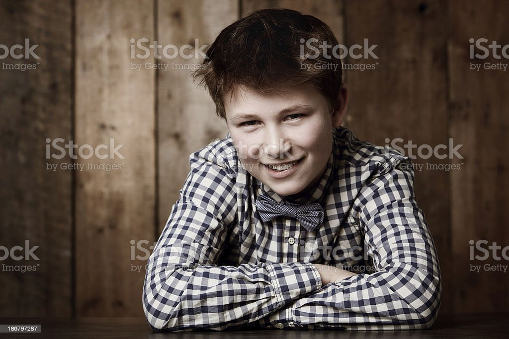 Enjoying being an individual Young boy in retro clothing smiling at you 10-11 Years Stock Photo