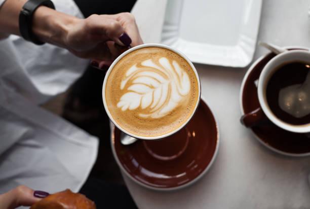 Enjoying cappuccino coffee stock photo