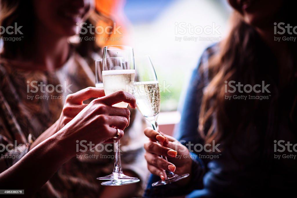 Enjoying champagne and good company stock photo