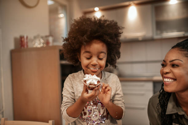 Enjoying Christmas Sweets Cute 5 years old girl enjoying in Christmas sweets. baked stock pictures, royalty-free photos & images