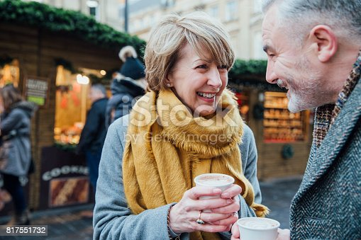 istock Enjoying Coffee At The Christmas Market 817551732