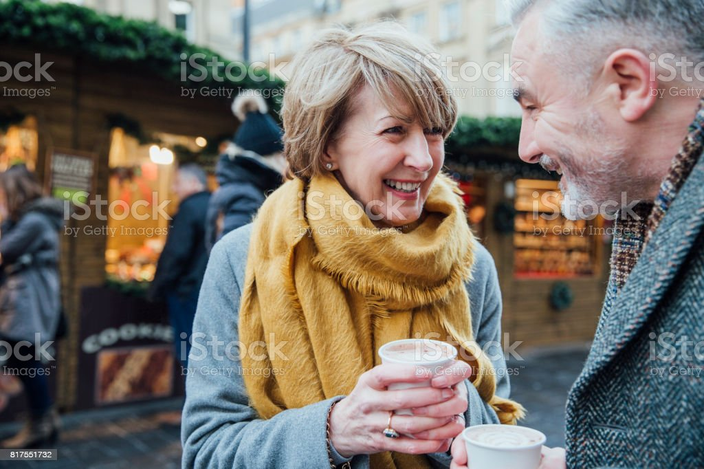 Enjoying Coffee At The Christmas Market stock photo