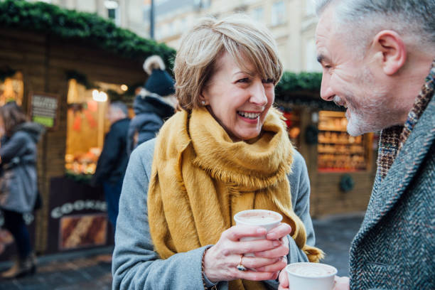 enjoying coffee at the christmas market - couple lap stock photos and pictures