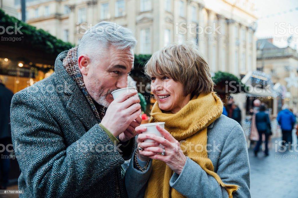 Enjoying Coffee At The Christmas Market royalty-free stock photo