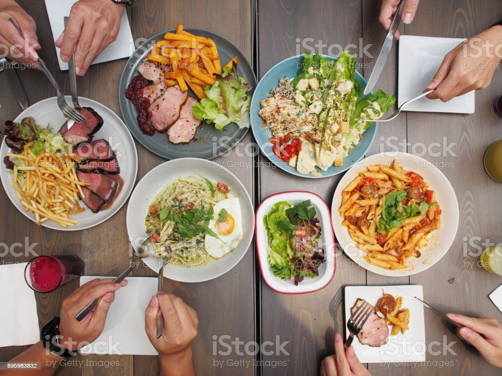 Enjoying dinner with friends. stock photo