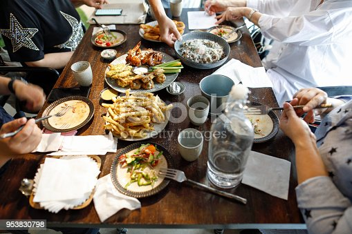 546450250istockphoto enjoying dinner with friends 953830798