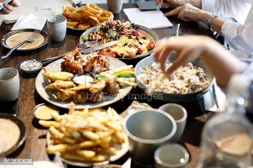 546450250istockphoto enjoying dinner with friends 953830836