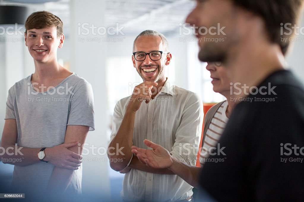 Enjoying discussions in a stand up meeting stock photo