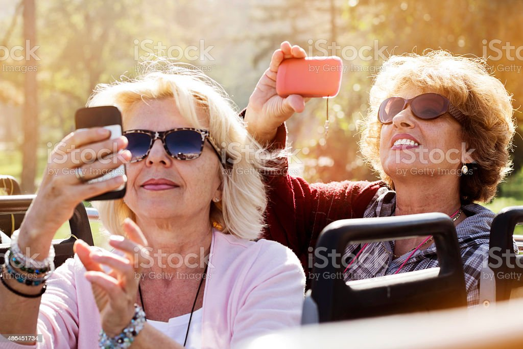 Enjoying Double-Decker Bus ride in city stock photo