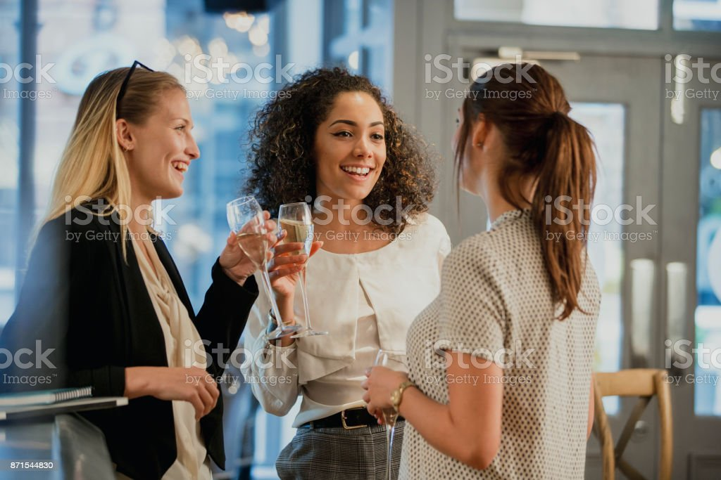 Enjoying Drinks After Work stock photo