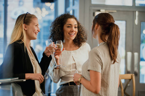 enjoying drinks after work - happy hour stock photos and pictures
